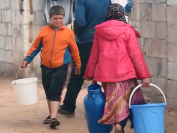 children in syria carrying water