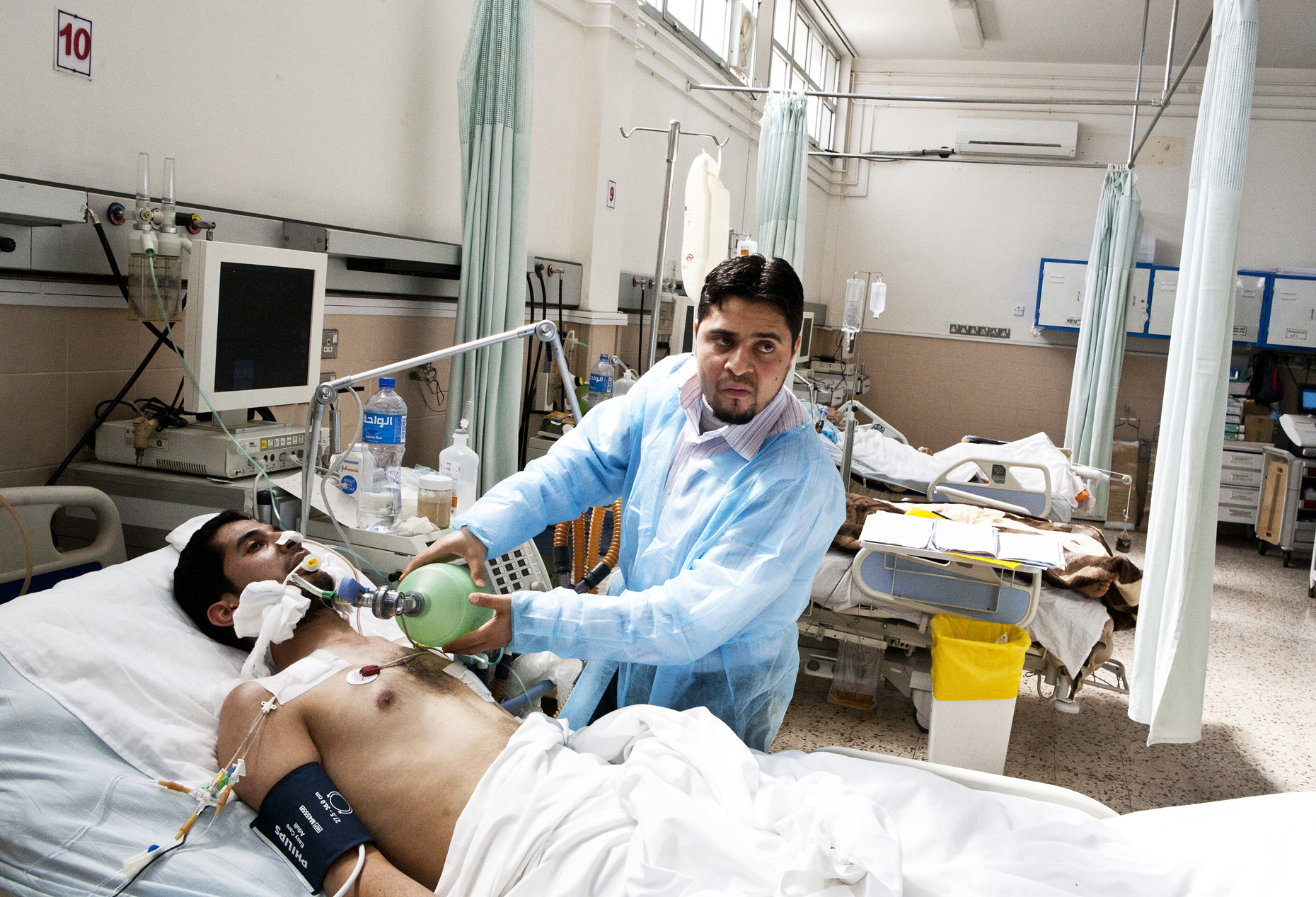 Hospital Patients Pictures : Aljalaa Hospital, Benghazi. A patient in the trauma section receives ...
