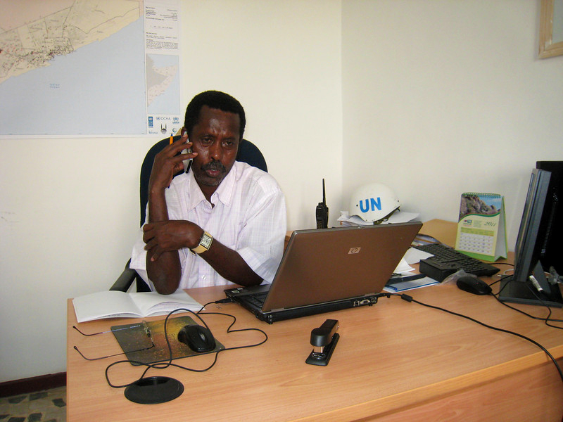 Ahmed Farah Roble speaks with a Somali NGO representative while in the