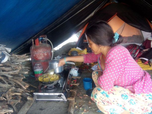 Parimaya Tamang a 29-year-old mother cooking for her family of five inside their tent in Alchidada site. Photo OCHA/Nima Kafle. & Aid worker diary: Many remain homeless following Nepal earthquake ...