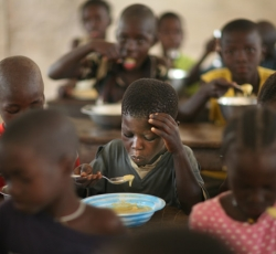 Pupils eat food donated by WFP in a classroom in Eva Orango school in Orango Island of Bijago Archipelago in Guinea-Bissau. According to the World Food Program (WFP) intellectual levels rise when children are fed properly. Credit: IRIN/Manoocher Deghati