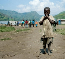 A child pauses briefly with a toy in an IDP camp in Minova, DRC. Credit: IRIN/Aubrey Graham