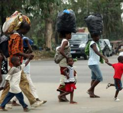A family hurries away from the Abobo neighborhood in search of safety. Credit: UNHCR/H.Caux