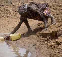 A man collects water from a reservoir near the town of Moyale in northern Kenya. Credit: IRIN/Siegfried Modola