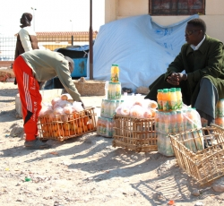 Some migrant workers have set up stalls at Salloum, selling basic items. Credit: IRIN/Kate Thomas