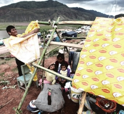 """Improvising Tents"". Peru - Cusco:  Inhabitants of Huacarpay improvising tents after flooding. Credit: José Jordán"
