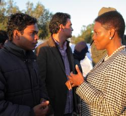 Emergency Relief Coordinator Valerie Amos at a transit camp near the Tunisian-Libyan border, speaking to people who have crossed into Tunisia to escape the violence. Credit: OCHA/David Ohana