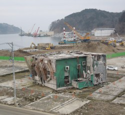 Ground Zero of the Onagawa port (next to Ishinomaki) - the green part of the lying building structure is its rooftop. Credit OCHA/Masaki Watabe