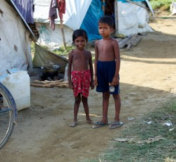 5 November 2012: Children stand in Thea Chaung camp. Credit: UNOCHA/ Nicole Lawrence