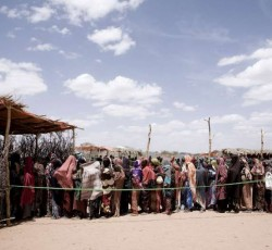 Dollow, Somalia: Women and children queuing for aid distribution at Kabasa transit centre. Credit: UNHCR/S. Modola