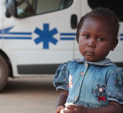 June 2014, Bangui, CAR: A young girl outside a health clinic on the outskirts of Bangui. The clinic has been rehabilitated with funding from the OCHA-managed Common Humanitarian Fund. Credit: OCHA/John James