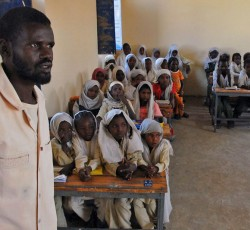 A teacher and his students in Dabkaraya El Bahar Village, White Nile, Sudan. Credit: OCHA/Matija Kovac