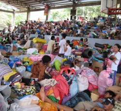 28 December 2011, Cagayan de Oro, Mindanao, the Philippines: Evacuation centres such as this one in Macasandig, Cagayan de Oro are overcrowded with over 335 families. More than 37,000 people remain in 54 evacuation centers in Iligan and Cagayan de Oro. Credit: OCHA/Kirsten Mildren