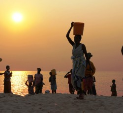 September 2013, Katanga, DRC: The sun rises over Tanganyika Lake on the far eastern edge of the Democratic Republic of the Congo (DRC). The lake is tainted with cholera, but for many families it is the only source of water. Credit: OCHA/Gemma Cortes