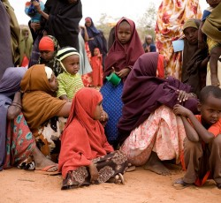 Women and children wait for humanitarian assistance in Dolo, southern Somalia. Credit: WFP/David Orr