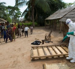 Healthcare worker disinfects areas where cases of deaths from Ebola have been reported. Credit: WHO