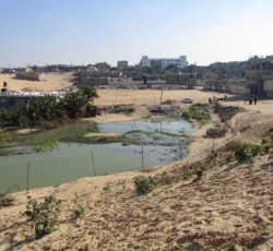 Sewage cesspool in the Qatatwa neighbourhood of Khan Younis, southern Gaza Strip. Credit: OCHA oPt