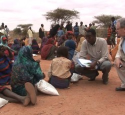 Humanitarian Coordinator for Somalia, Mark Bowden (right), speaks to people displaced by the drought. Credit: OCHA