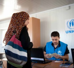 Cash assistance to IDPs in Al NAbek, Rural Damascus, August 2012. Credit: UNHCR