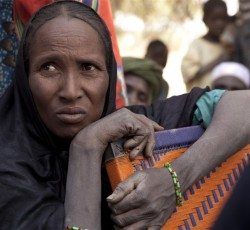 A Malian refugee woman in Mangaize, northern Niger, ponders her future. Credit: UNHCR/H.Caux