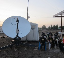 Aid workers using satellite and internet services in Pibor, South Sudan. Credit: Rob Buurveld/FITTEST/2012