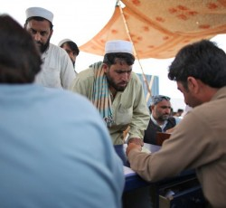 2012, Khyber Pakhtunkhwa, Pakistan: A man registers his arrival at the Jalozai displacement camp in north-west Pakistan. More than 1 million people have been displaced by violence in the region since 2008, including thousands of people living with physical and mental disabilities. Credit: IRIN/Tim Irwin