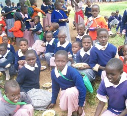 May 2012: Students at Meto Primary School receiving a nutritious lunch of maize and beans during the school feeding programme. Credit: OCHA