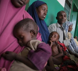 Mogadishu, Somalia: Parents wait with their malnourished children at Banadir Hospital. Four million people urgently need assistance in the country. Credit: AU-UN IST PHOTO/Stuart Price