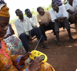 March 2015, Bambari, CAR - Marie-Hélène Nzapanede listening to Radio Lego Ti la Ouaka at the Sangaria site for internally displaced people. Credit: OCHA/Gemma Cortes