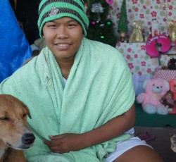 27 Nov 2013, Philippines: Maribel with her dog, Lang-Lang. She was worried that her dog was washed away in the storm surge following Typhoon Haiyan. Credit: OCHA/Eva Modvig