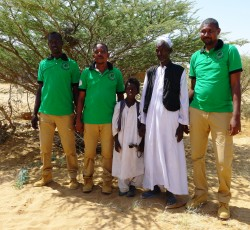 Hassan Hamad Adam and son Ali with members of the National Demining Unit. Nearly ten million square miles of land in East Sudan are hazardous because of mines and other unexploded ordnance. Credit: OCHA/Jennifer Paton