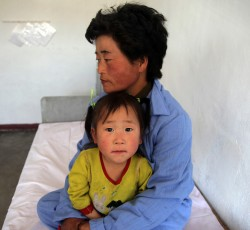 A mother and child in the WFP, WHO, UNICEF-supported Provincial Pediatric Hospital in Hamhung City, DPRK. Credit: OCHA/David Ohana