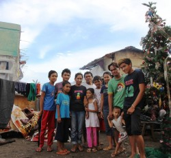 23 December 2013: Rodolfo and Marideth Miraflor, with their 9 children, made a Christmas tree near their house in Tacloban city. They wanted to share the spirit of Christmas with their neighbours despite the desolation surrounding them after Typhoon Haiyan struck the city last November. Despite the challenges, people want to celebrate Christmas and share laughter and hope. Credit: OCHA/Gemma Cortes