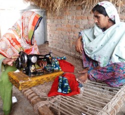 2013, Sindh, Pakistan: Haseena (right) and her daughter, with a sewing machine they purchased with a cash grant from the International Rescue Committee. The grant helped Haseena and her family recover from the floods that devastated her community in late 2012. Credit: IRC