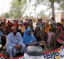 A flood affected community in Sindh listening radio programmes providing vital information on the humanitarian response in the region. Credit: Internews