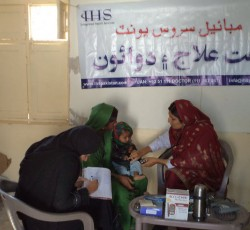Doctor and health worker treating women and children at mobile clinic set up by Integrated Health Services in Khalifa Abdul Ghani, District Shaheed Benazirabad. Credit: IHS/Sajjad Hussain