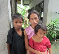 Melanie with her two children at a day care centre used as evacuation centre, Barangay Cross, Glan, Sarangani, 14 June 2012. Credit: OCHA/Melindi Malang