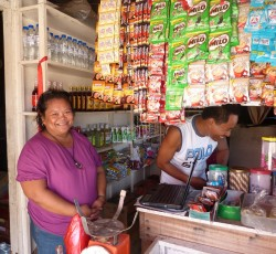 January 2013, Mindanao: Evangeline in her small corner shop in Cateel. Along with basic groceries she also sells mobile phone charging services. Credit: OCHA/Eva Modvig