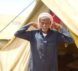 Saleh Ali Showi pictured in front of his family tent at Al Mazreq camp, Haradh. Credit: Adel Yahya