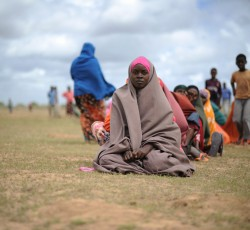 Internally displaced people (IDP) wait patiently at a food distribution center in Afgoye, Somalia. The 1.1 million people in  IDP settlements across Somalia need urgent health, shelter, water, sanitation and hygiene support. CREDIT: AU UN IST PHOTO/TOBIN JONES