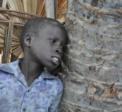 March 2014, Unity State, South Sudan: A young boy displaced by violence in Unity State in northern South Sudan. Hundreds of thousands of people have been displaced by the crisis that has gripped this country in recent months. Credit: OCHA