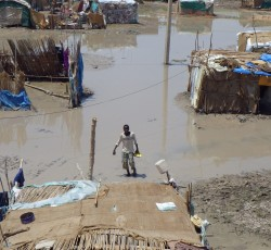 September 2013, Khartoum, Sudan: A boy stands in flood water in Khartoum's Soba Kangour neighbourhood. Tens of families were affected by the floods that struck in August and September. Credit: OCHA