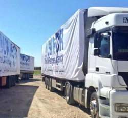 20 March 2014, Nusaybin, Turkey: For the first time in three years, a humanitarian convoy has crossed from Turkey into northern Syria. Credit: UNHCR