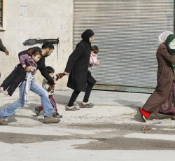 2012, Idlib, Syria: Civilians flee from fighting after Syrian army tanks entered the northwestern city of Idlib, Syria. Credit: Nasser Nouri/Flickr