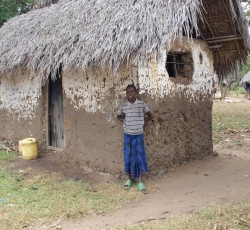 Violence since August 2012 in Kenya's Tana Delta region has led to the displacement of scores of people. Here, a boy stands in front of a small hut, home to 15 displaced people. Credit: UNICEF/Limbu