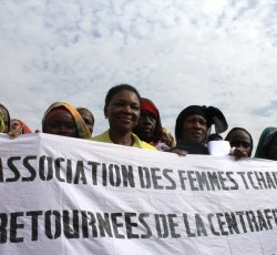 "6 May 2014, N'Djamena, Chad: ERC Valerie Amos show solidarity with women living in the transit site of Zafaya in Gaoui in the outskirts of the capital N'Djamena. Banner reads: ""Association of Chadian women returned from Central African Republic"". The site houses over 3,000 people evacuated by plane from Bangui, CAR to Chad from December 2013 to February 2014. Credit: OCHA/Philippe Kropf"