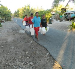 Islanders in Tuvalu on the daily trek to get water. Credit: Tuvalu High Commissioner in Suva, H.E. Aunese Makoi Simati
