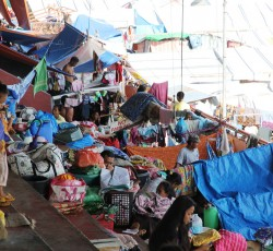 Dec 2013, Zamboanga, the Philippines: Almost 60,000 people are still displaced in Zamboanga City on the southern Philippine island of Mindanao. Thousands are crammed into evacuation centres, including this one at the city's sports stadium. Credit: OCHA/Gemma Cortes