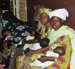 Mothers and their children wait in line at the nutrition center in Bamako, Mali. Credit: OCHA