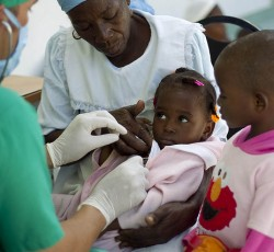A doctor checks a child for cholera at a hospital adjacent to a cholera treatment center in Lester, a town 2 hours north of Port au Prince, Haiti. Credit: MINUSTAH/ Logan Abassi
